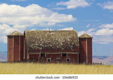 An old and abandoned red barn in rural eastern Washington