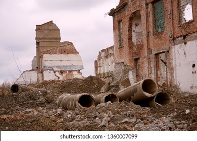 Old abandoned ruined building. Old sugar-mill. Collapsed brick-wall industrial buildings. Demolished plants. Ruins of the factory sugar refinery.