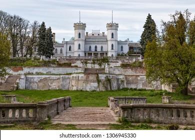 Old  abandoned ruined Sharovka Castle ( Sharivka Palace )  in neo-Gothic style, Kharkiv region. General front view . Ukraine.