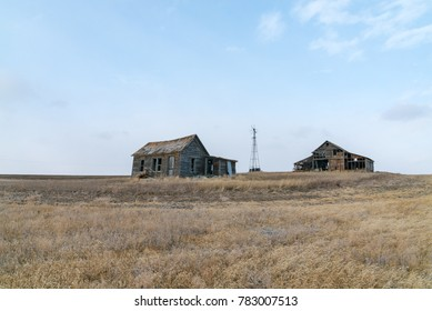 An old abandoned rural homestead farm in the plains of northeast Montana.