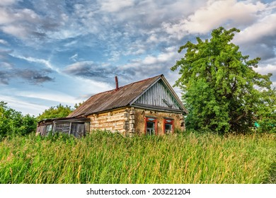 Old abandoned rural hut in russian countryside