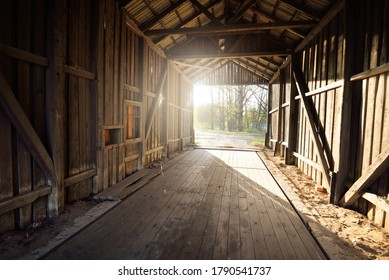 An old abandoned rustic wooden shed, close-up. Agriculture, farm industry, traditional architecture, USA, Wild West, history, gold mine, western, zombie, horror and other graphic resources concepts
