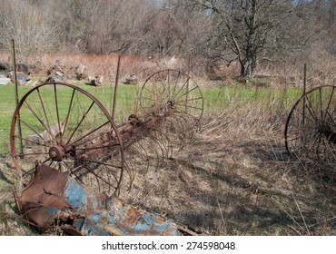 Old abandoned rusty agricultural machines and tools