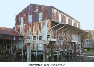 Old abandoned rusty seafood processing house along the Apalachicola River, Apalachicola, Florida, USA