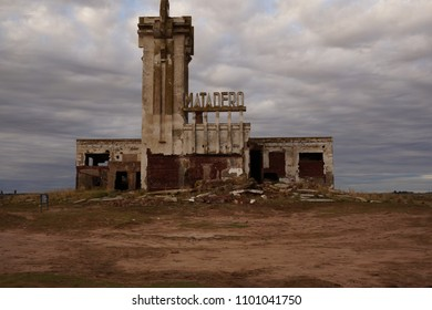 Old abandoned slaughterhouse in Epecuen ghost town. Designed by architect Francisco Salamone. The sign next to the tower is slaughterhouse in spanish