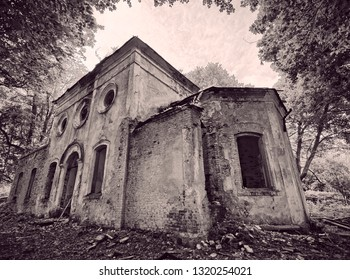 Old abandoned St. Nicholas Church ruins in Estonia. The lush foliage of trees and forest covering the beauty of this ancient ruined building. Sepia colored.