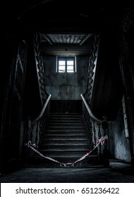Old abandoned stairs going up to the another floor. Horror feels