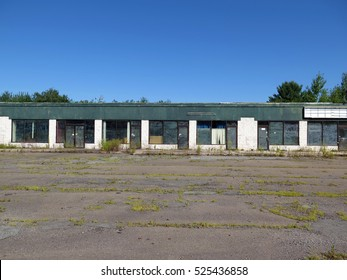 Old abandoned strip mall on a beautiful, sunny day.