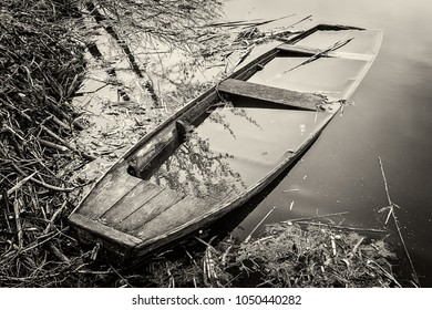 old abandoned and submerged boat