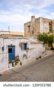 Old abandoned town. Narrow street in old Greek village. Traditional buildings. Destroyed house. Hersonissos. Crete Island, Greece