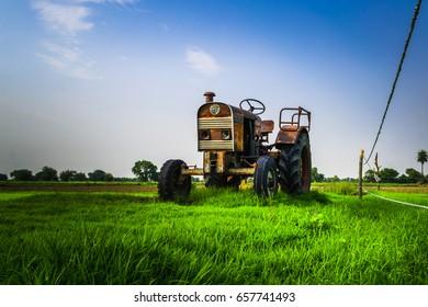 Old abandoned tracktor display at crop field