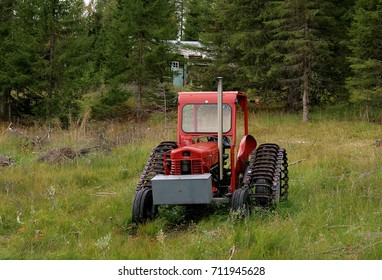 Old abandoned tractor in a rural landscape