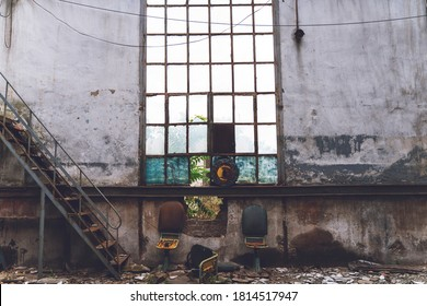 Old abandoned train station building and broken window and chairs with rust