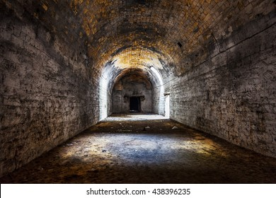 Old abandoned tunnel in the underground wine cellar. Entrance to the catacombs in Odessa, Ukraine. As a creative background for staged dark design