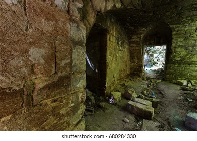 An old abandoned tunnel in an underground wine cellar. Entrance to catacombs. Dungeon An old stone fortress. As a creative background for staging dark design. Mystic interior of an ancient dungeon