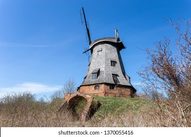 Old abandoned windmill with broken sails