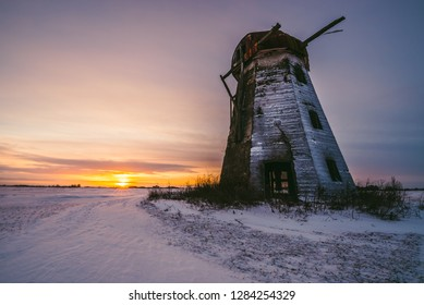 Old abandoned windmill in the fields on sunset time. Lithuania, Pasvalys