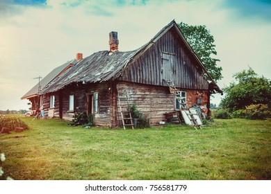 Old abandoned wooden barn at village outskirts