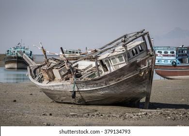Old abandoned wooden boat in Bandare Loft village on Qeshm island, Iran