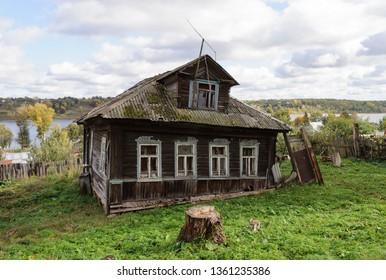 Old abandoned wooden house with mezzanine near the Volga riverbank. Tutaev town, Yaroslavl region, Russia.