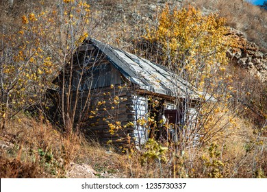 Old abandoned wooden house on the mountainside.