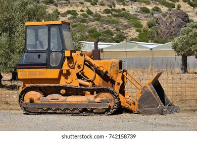 Old abandoned yellow bulldozer. Old rusty and weathered bulldozer.