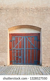 Old abtique wooden gate and old brick wall. Close gate.