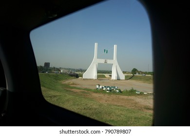 Old Abuja City Gate in Abuja, Nigeria viewed from inside of a vehicle from the expressway