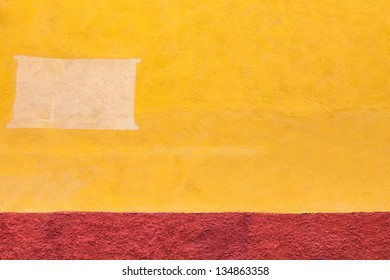 Old adobe wall abstract background. Textured fragment of painted wall. Architecture background.