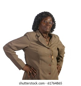 Old African American woman standing and looking irritated