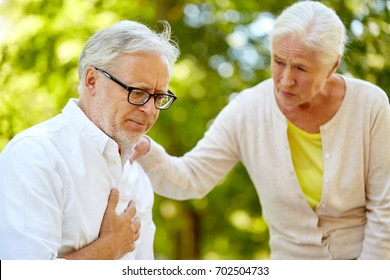old age, health problem and people concept - senior man feeling sick at summer park