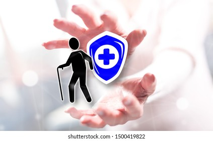 Old age insurance concept between hands of a woman in background
