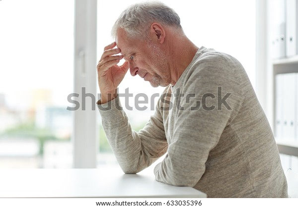 old age, problem and people concept - close up of senior man thinking