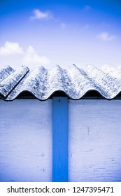 Old aged dangerous asbestos roof - one of the most dangerous materials in buildings so-called 'hidden killer'