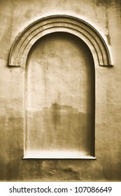 Old aged plastered faux arch false fake window stucco frame background copy space, light dark beige sepia texture
