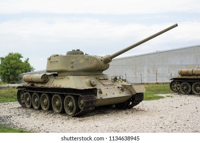 Old aged soviet tank from second world war - Armored fighting vehicle with cannon is parking.