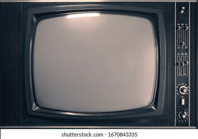 Old,  aged  television isolated  on gray wall background, retro vintage tv style. empty white screen.