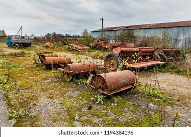 Old agricultural machinery. .Abandoned collective farm. Russia, Tula region.