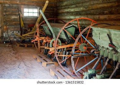 Old agricultural machinery. Interior of a rural wooden shed.