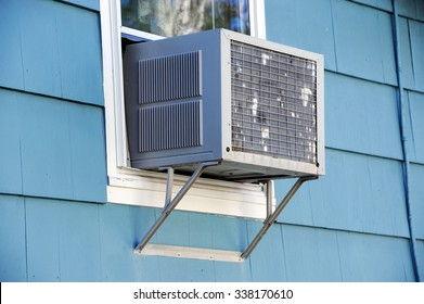old air conditioner installed on window