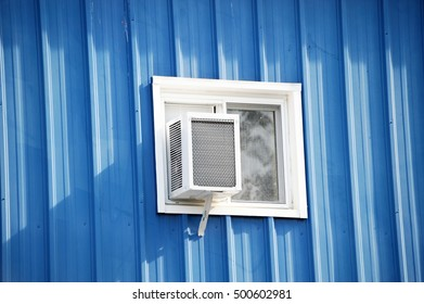 old air conditioner installed on house window