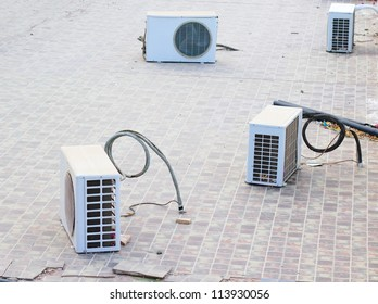 old air conditioners on the roof without installment