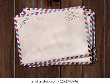 Old air mail envelopes on wooden table.