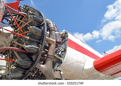 Old aircraft against blue sky, aircraft engine close up