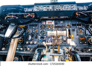 Old aircraft cockpit closeup with many gauges and yoke
