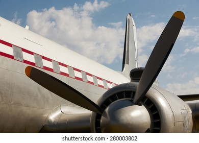 Old aircraft propeller and airframe with blue sky background. Horizontal
