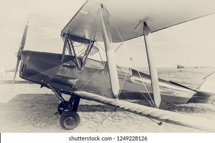 Old airplane at the airfield. Air travel with biplane - concept of retro aviation. Retro image of old aircraft. Vintage airplane closeup.