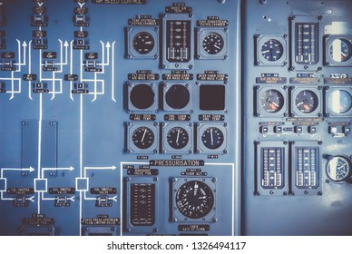 Old airplane control panel in cockpit. Industrial grunge background