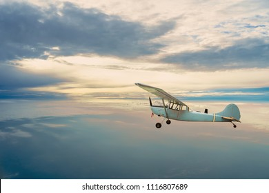 Old airplane on the blue sky