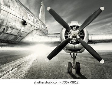 old airplane on a runway
